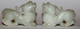 A Pair Of Chinese White Jade-like Models Of Dragons,