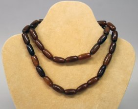 A Good Quality Chinese Horn Bead Necklace, Possibly