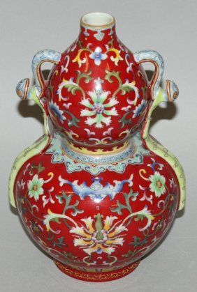 A Chinese Red Ground Famille Rose Double Gourd