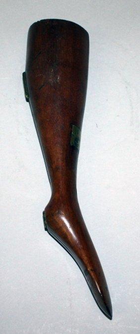367. A Rare Mahogany Long Leg, 12ins Long, Enclosing A