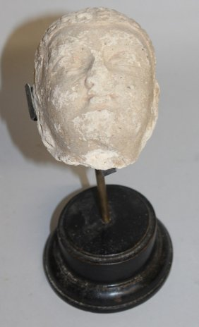 412. An Early Indian Carved Stone Head. 4ins Long, On