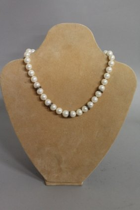 617. A Good Pearl, White Gold And Diamond Necklace.