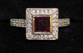 691. A Square Cluster Ring, Set With Garnets And