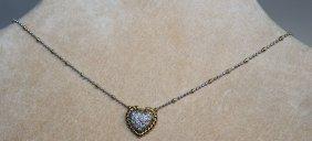 724. An 18ct White Gold Diamond Set Heart Shaped