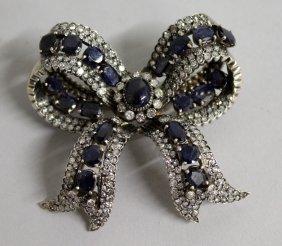 733. A Superb Sapphire And Diamond Ribbon Brooch.