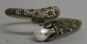 766. A Silver Serpent Bangle With Pearl And