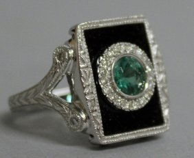 781. A 14k Gold Emerald, Diamond And Onyx Deco Ring.