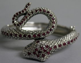 784. A Heavy Silver And Ruby Snake Bracelet.