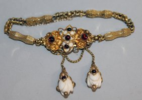 811. A Victorian Gold Gem Set Bracelet.