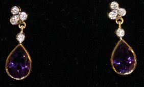 853. A Pair Amethyst And Diamond Earring, Set In