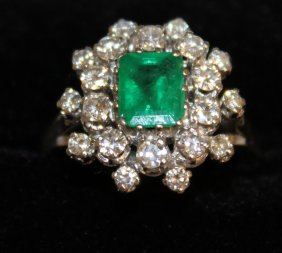 877. A Good Emerald And Diamond Cluster Dress Ring,