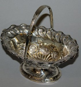 933. A Victorian Boat Shaped Sugar Basket, With Swivel