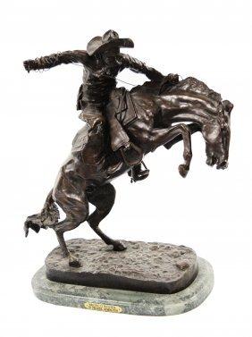 "A Frederic Remington Cowboy Bronze Statue ""bronco"