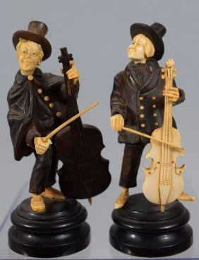 Group Of Two Wooden Musicians Playing Instruments