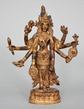 An Oriental Gilt Bronze Polychrome Figure, Representing