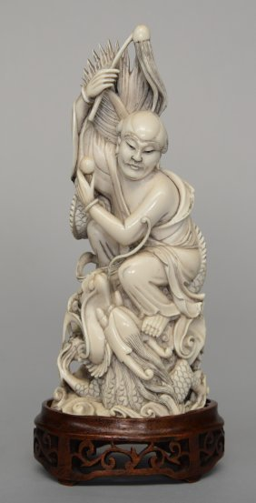 A Chinese Ivory Sculpture Figuring A Deity Sitting On A