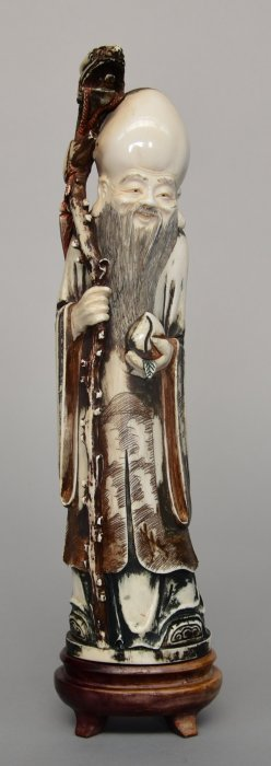 A Chinese Ivory Shou Xing, On Wooden Base, Polychrome
