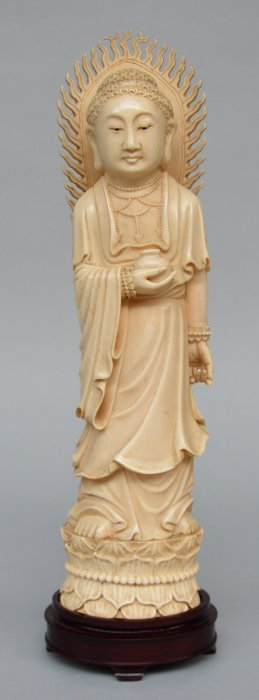 A Chinese Ivory Buddha On Wooden Base, First Half Of