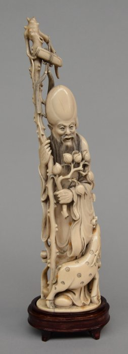 "A Chinese Ivory Carved Figure Depicting ""shou Xing"" On"