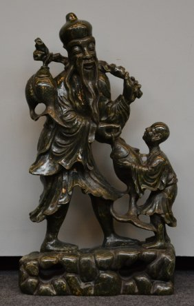 A Chinese Jadeite Sculpture Of A Fisherman With Child,