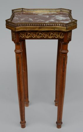 A Neo Classical Walnut Occasional Table With Brass
