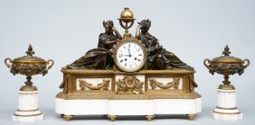 A Neoclassical Gilt And Patinated Bronze Mantel Clock