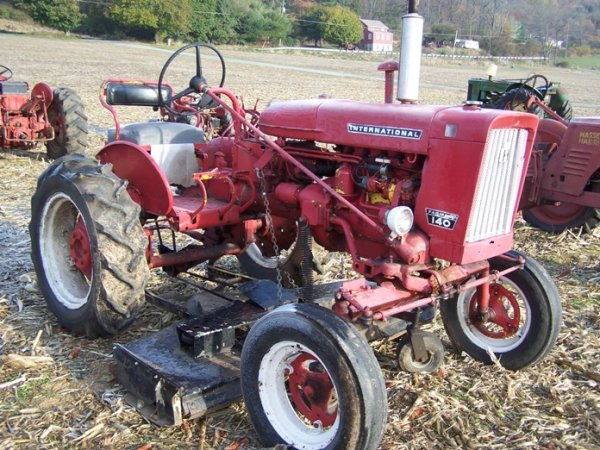 Farmall 140 Tractor : Farmall tractor with woods belly mower lot