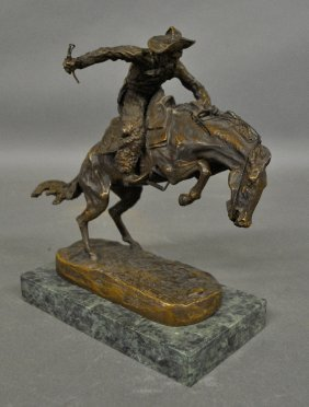 Bronze Of A Cowboy Mounted On A Marble Base Signed