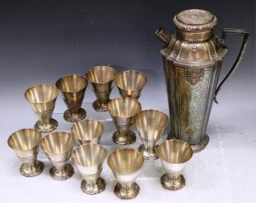 Set Of Silver Pitcher And 12 Matching Cups