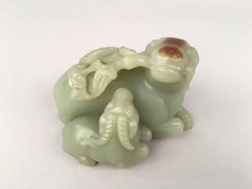A Chinese Jade Figure Group Of Goats