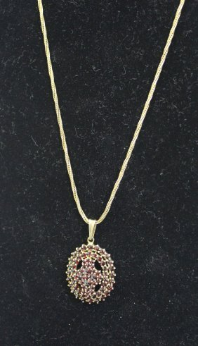 A Yellow Metal Garnet Cluster Pendant Oval; Together