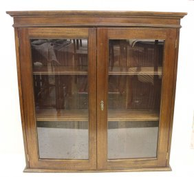 A Mahogany Glazed Bookcase, Two Doors Opening To Reveal