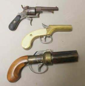A Grouping Of 3 Antique Pistols.