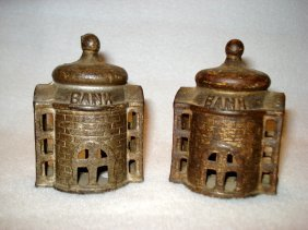 Matching Pair Of A.c. Williams Cast Iron Still Banks.