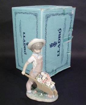 Boxed Hand Painted Lladro Figure Of A Boy With Whe