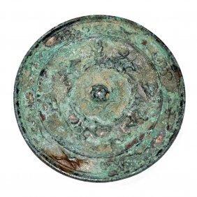 Tang, A Silvery Bronze Equestrian Mirror
