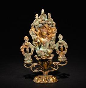 A Gilt-bronze Figure Of Buddhas