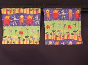 A PAIR OF HOME-MADE CURTAINS, THE CHILDRENS FABRIC