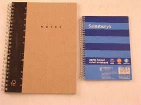 AN A5 SPIRAL BOUND NOTEBOOK AND ANOTHER SMALLER