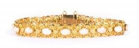 A Lady's Gold Angel Skin Coral Link Bracelet