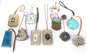 An Assortment Of Enamel Guilloche Compacts