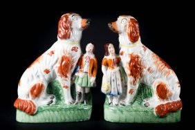 Pair Of Staffordshire Dog And Child Figures