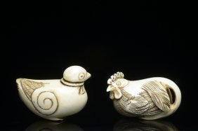 A Pair Of Ivory Birds