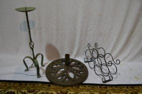 Three Metal Objects: Candle Stand, Umbrella Stand,