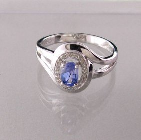 APP: 1k 18kt Gold, Tanzanite W/Diamond & Silver Ring