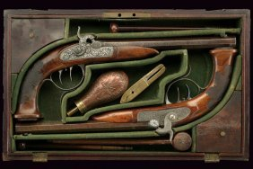 A Rare And Fine Pair Of Cased Percussion Pistols By J.