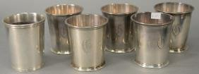 Six sterling silver cups, monogrammed (one is non