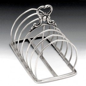 A Victorian Six Divide Silver Toast Rack.