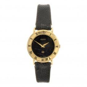 A Gold Plated Quartz Lady's Gucci 3000L Wrist Watch