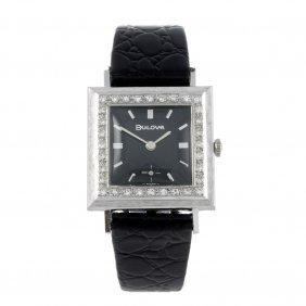 Bulova - A White Metal Wrist Watch.